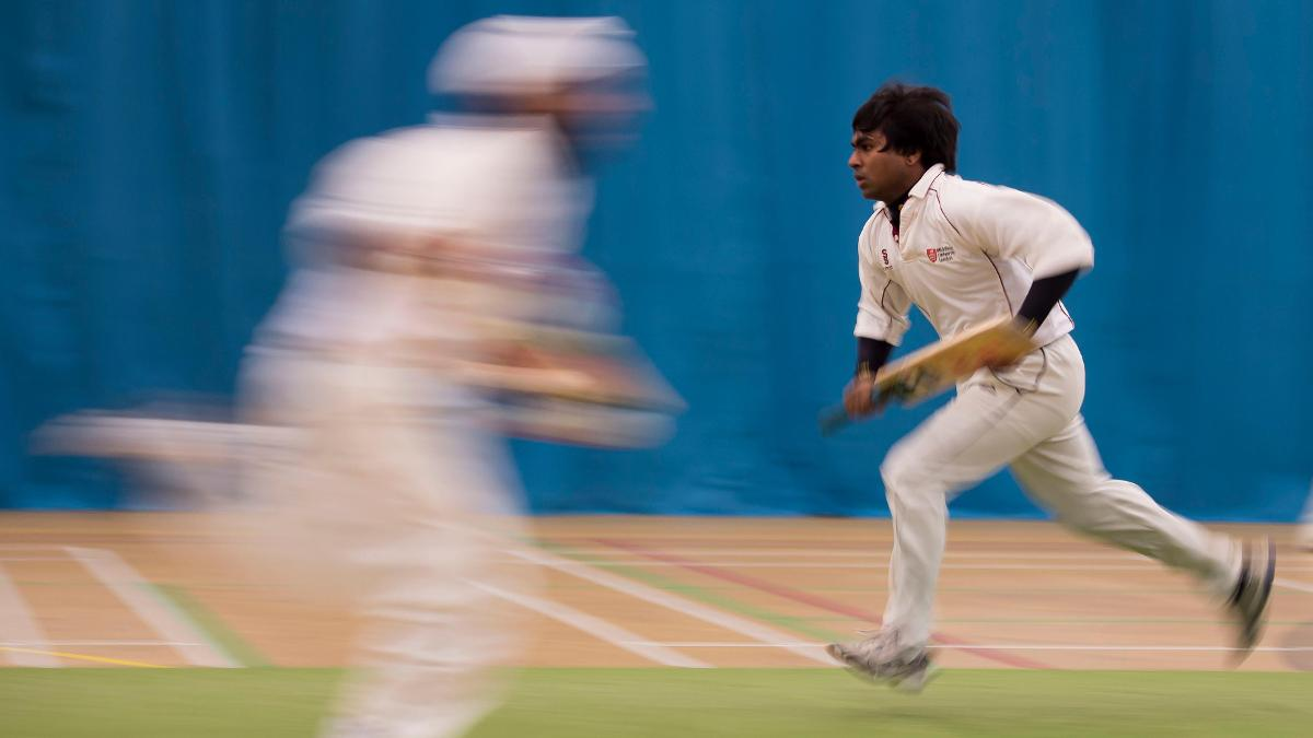 Indoor players run between the wickets