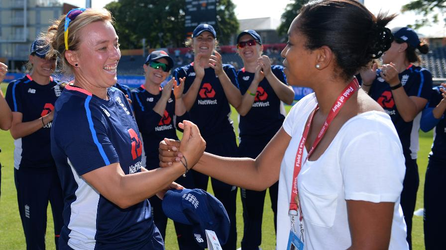 Dani receives a cap from former England teammate Ebony Rainford-Brent before playing in her 50th ODI at the ICC Women's World Cup in 2017.