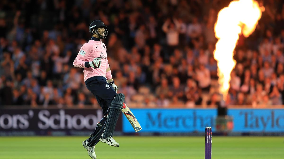 Steven Finn celebrates hitting the winning runs for Middlesex in the London derby as he smashes the ball to the boundary