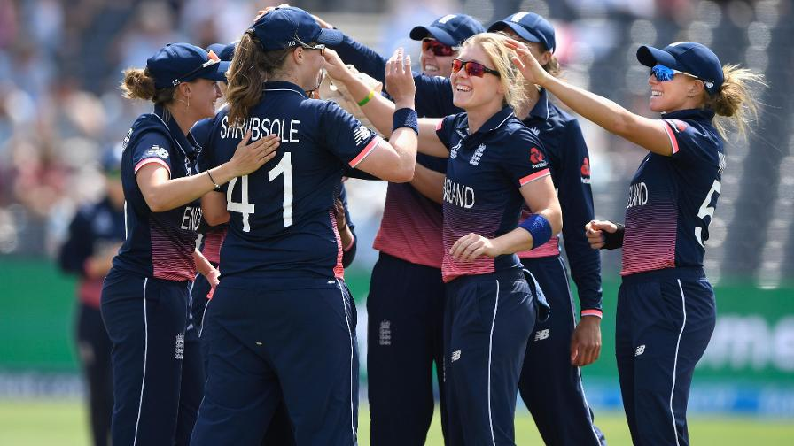 England celebrate two wickets in the 32nd over which left South Africa 133/4