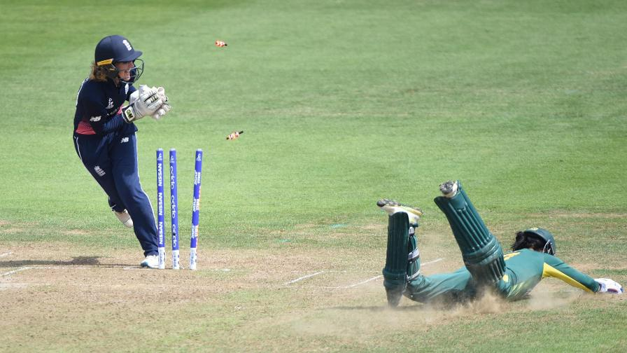 Sarah Taylor whips off the bails - one of two run outs - as South Africa finished on 218/6