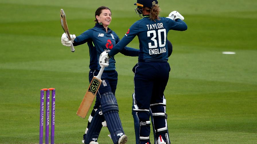 Tammy Beaumont and Sarah Taylor take a moment to enjoy their success