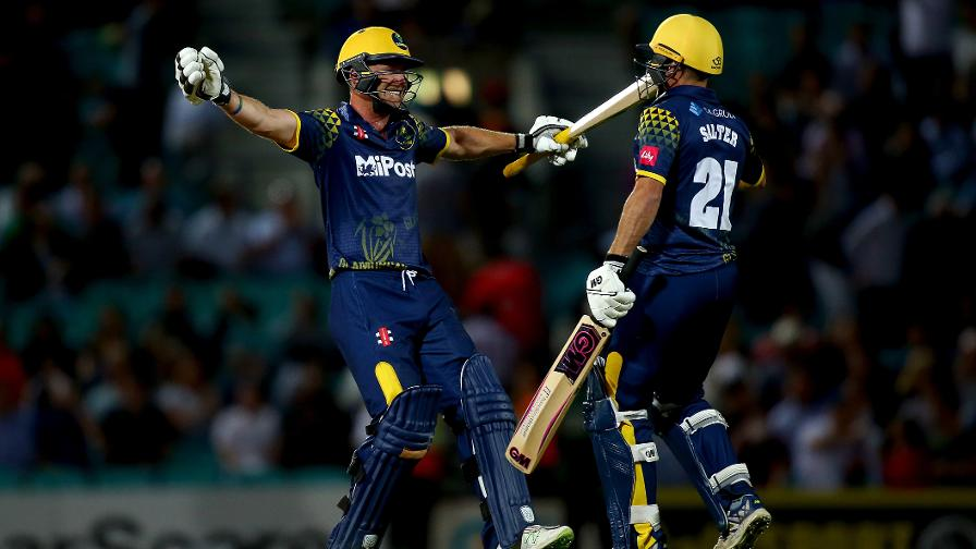 Graham Wagg and Andrew Salter of Glamorgan celebrate after sealing victory against Surrey