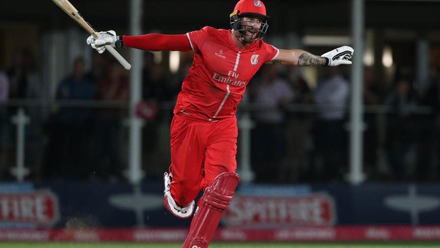 Jordan Clark wheels away in celebration upon Lancashire reaching Finals Day
