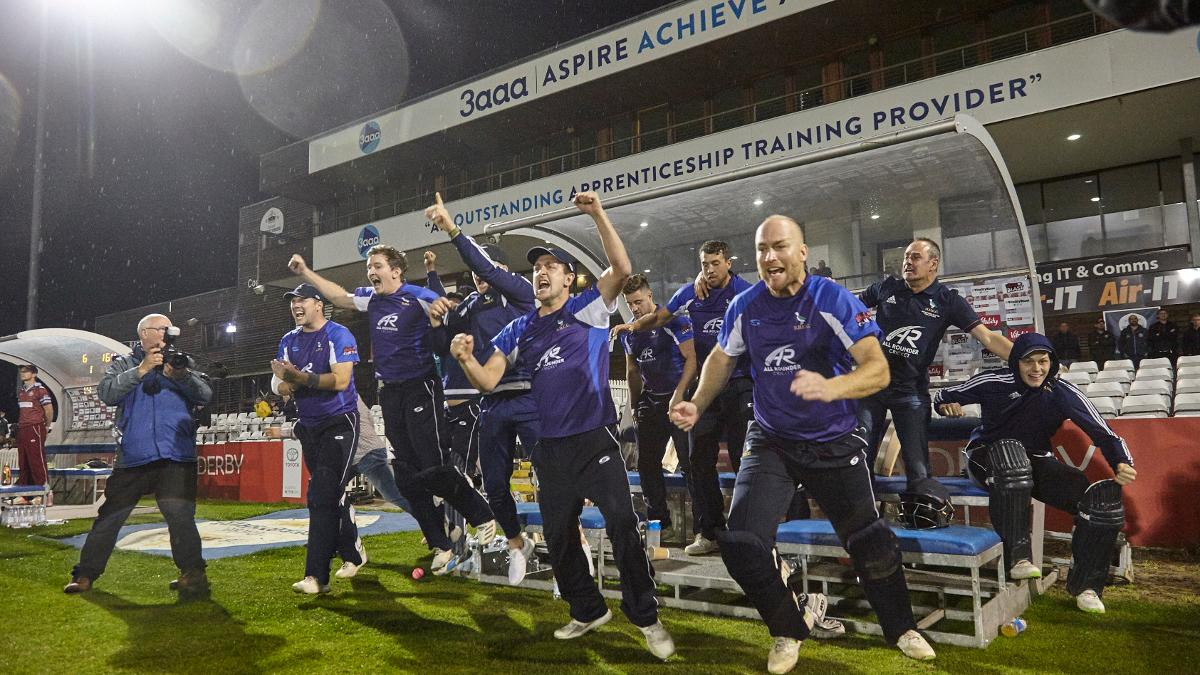 Hanging Heaton players celebrate after the final ball