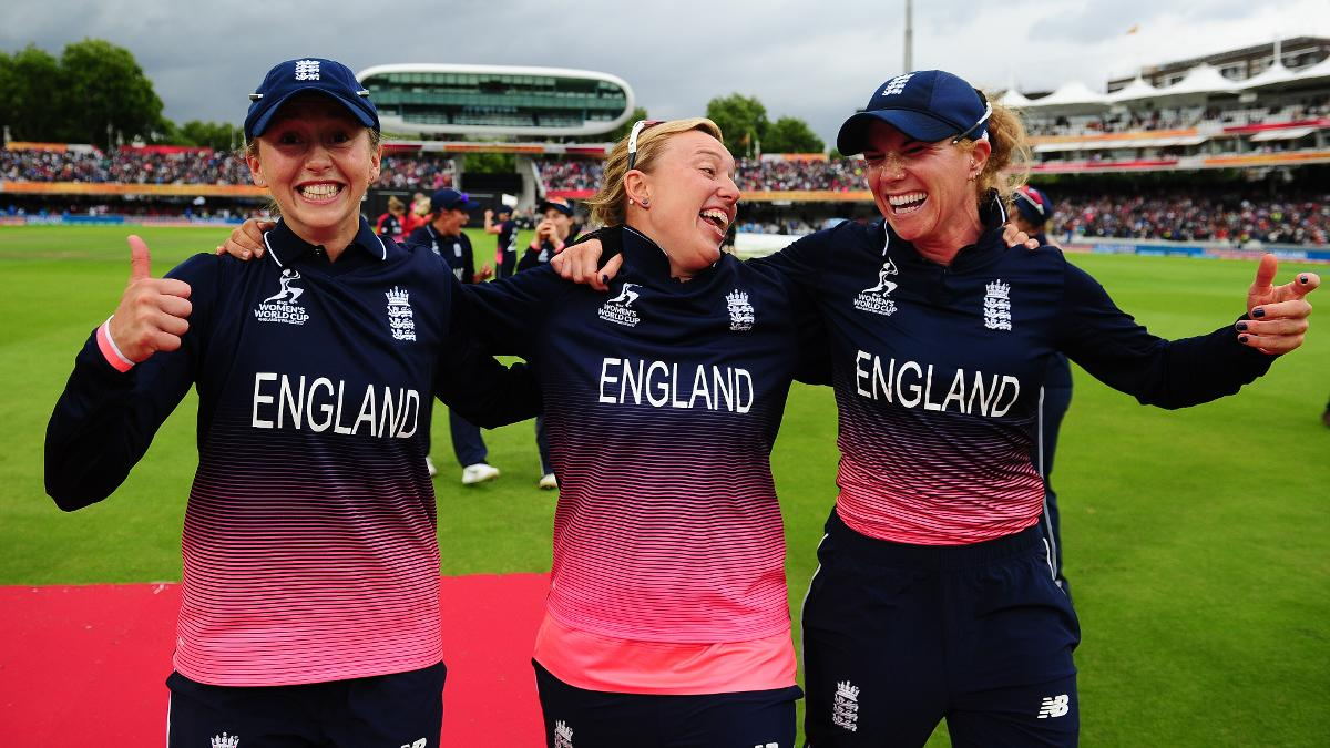 Hazell celebrates with teammates Fran Wilson and Lauren Winfield after England's famous 2017 World Cup win at Lord's