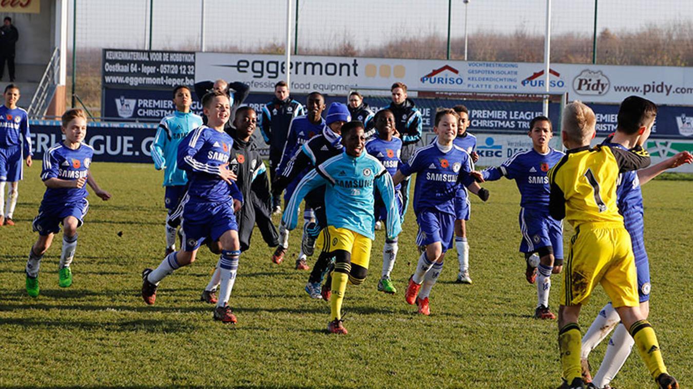 Chelsea players celebrate Livramento's winning penalty in the semi-final