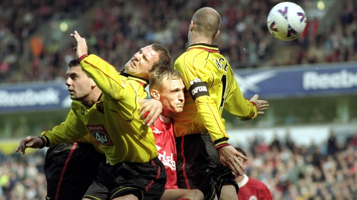 Robert Page wins a header during Watford's shock win at Liverpool