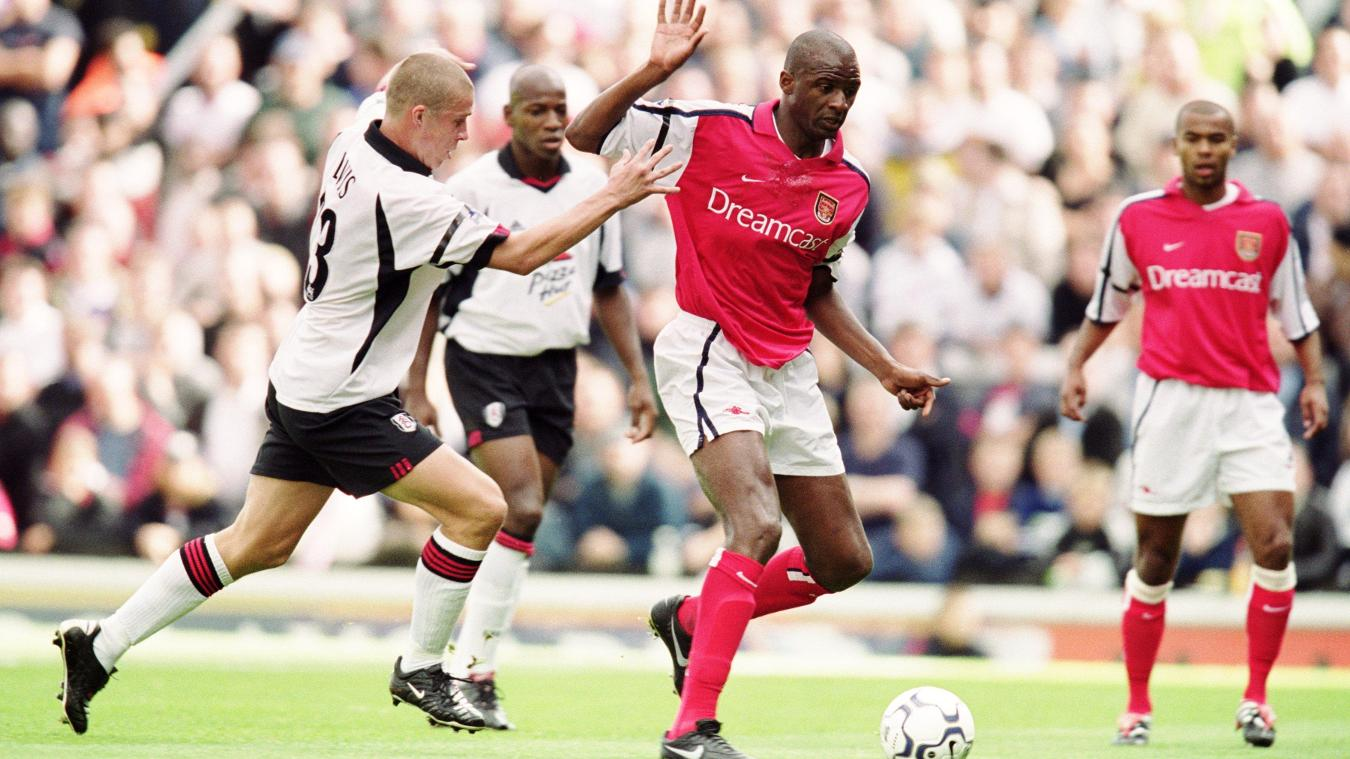 Arsenal midfielder Patrick Vieira takes on Sean Davis in a 3-1 win for the champions