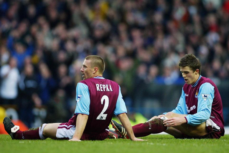 West Ham's Tomas Repka and Michael Carrick look dejected