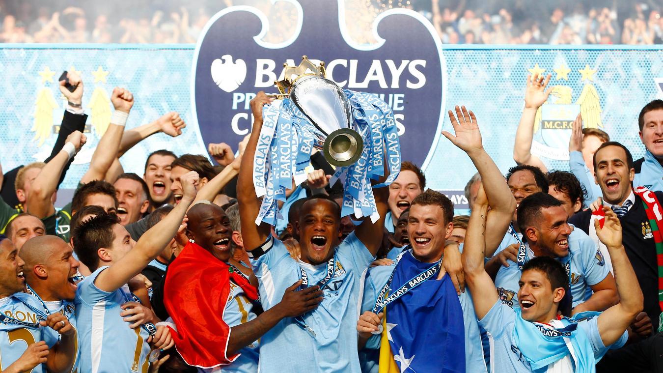 Man City captain Vincent Kompany lifts the Premier League trophy in May 2012