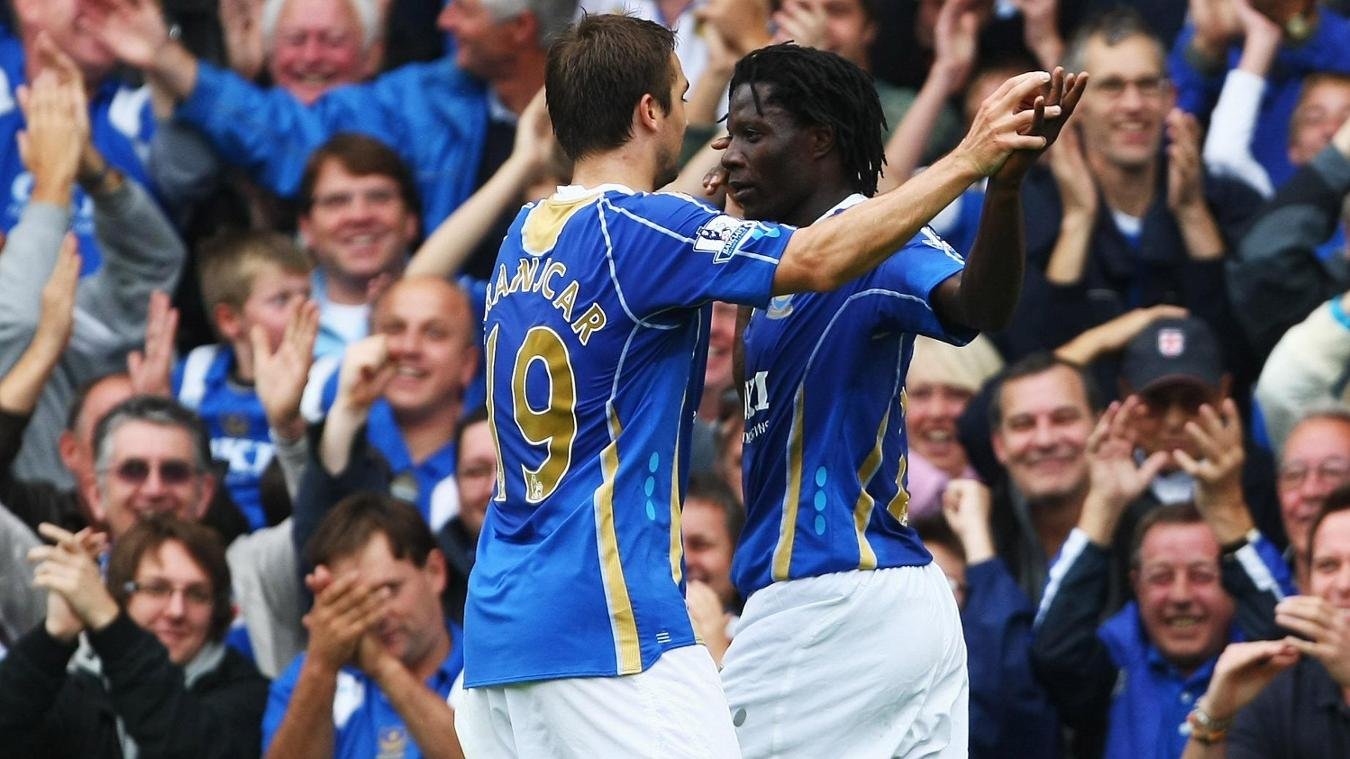 Hat-trick scorer Benjani is congratulated by Portsmouth team-mate