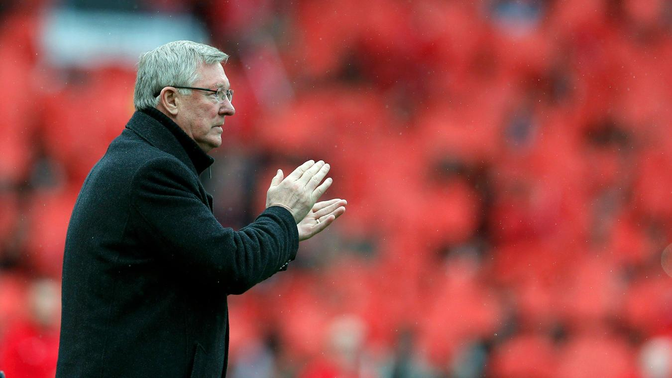 Sir Alex Ferguson takes in the applause on his last match at Old Trafford