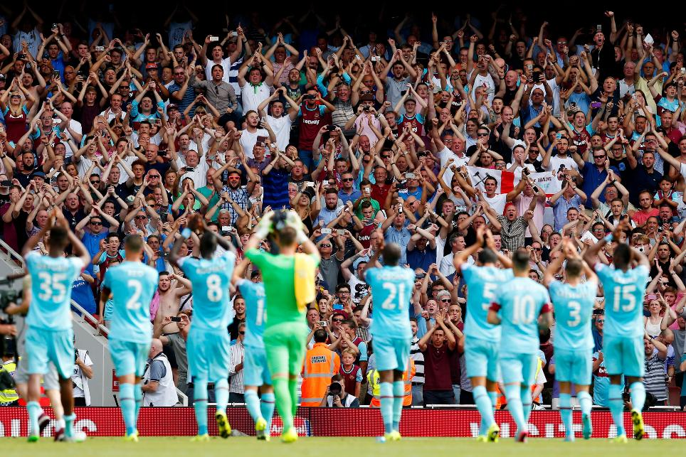 West Ham players applaud their fans after a win against Arsenal at Emirates Stadium