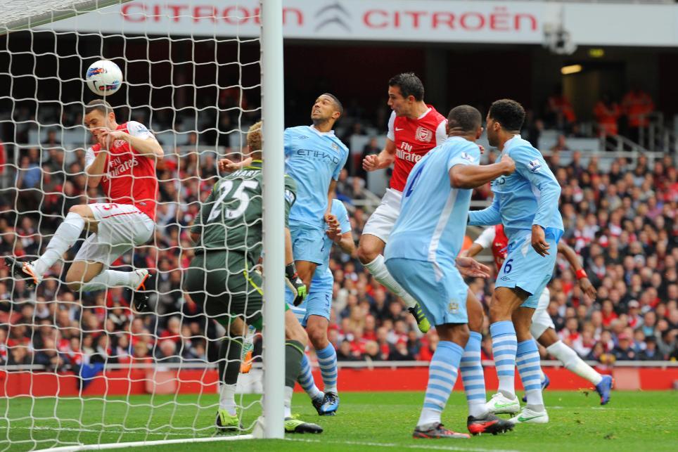 ARS-2011-12-robin-van-persie-header-blocked-thomas-vermaelen-scramble-goal-line
