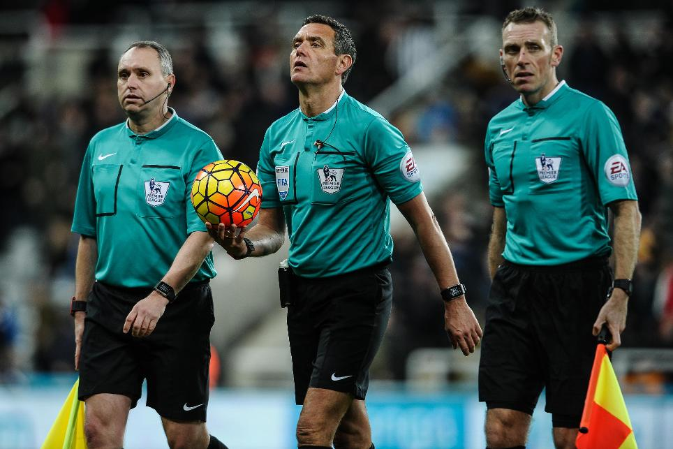 Select Group referee Andre Marriner and two assistants