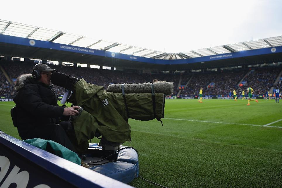 A cameraman at a Premier League match