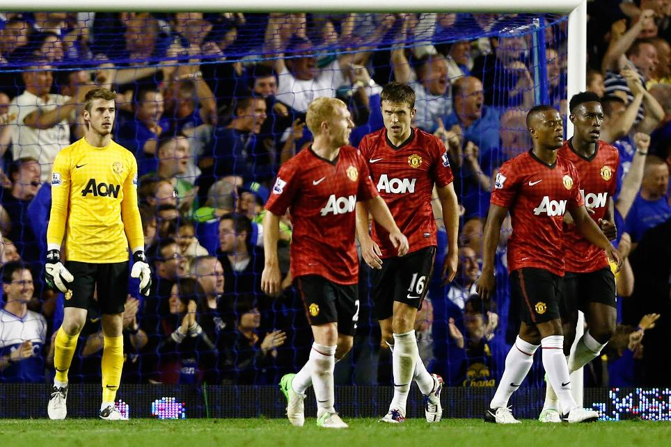 Manchester United players dejected after an opening-day loss at Everton in 2012